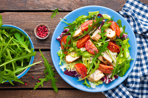 Vegetable salad with chicken meat. Salad with fresh vegetables a
